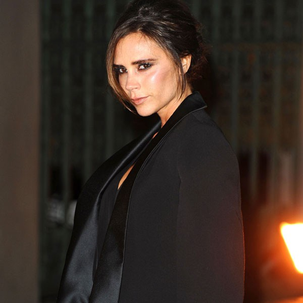 Victoria Beckham wears a black cape for a night out in London